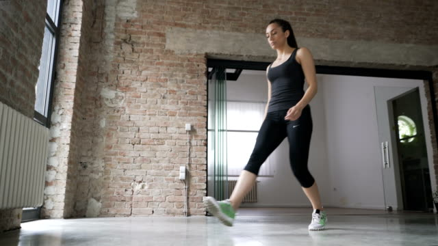 young woman doing forward lunges at home - lunge stock videos & royalty-free footage