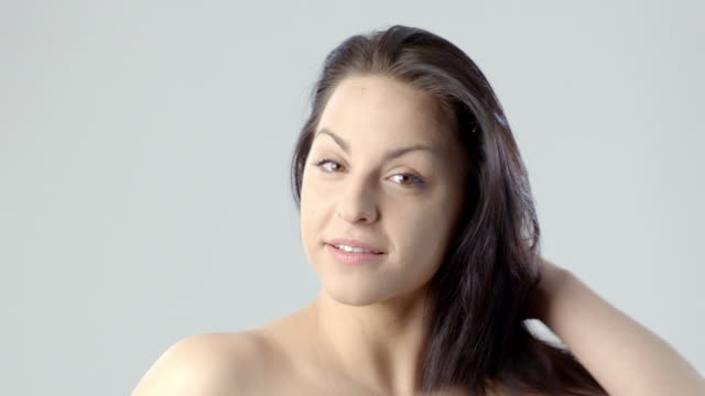 young woman doing her beautiful hair - girls flashing camera stock videos and b-roll footage