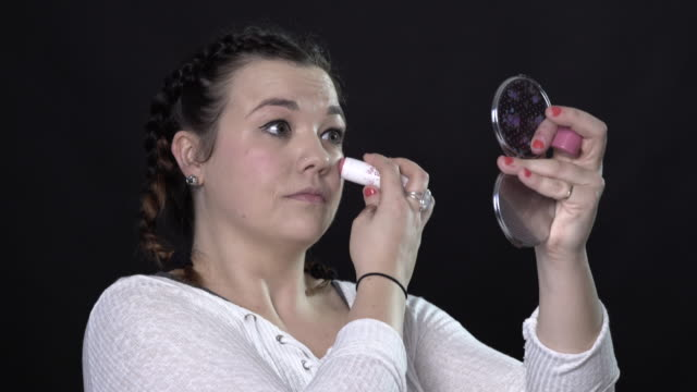 a young woman doing her own make-up - blusher stock videos & royalty-free footage