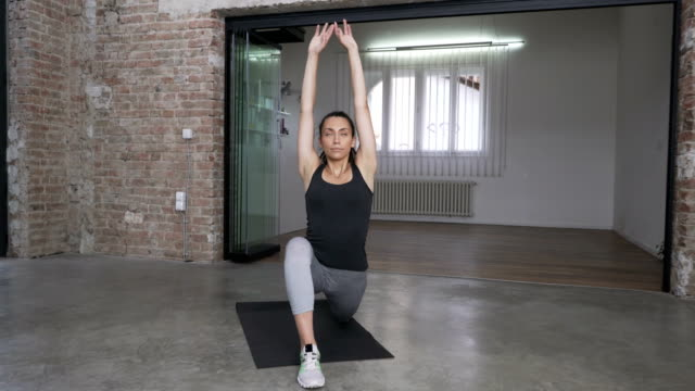 young woman doing low lunge arch - pilates stock videos and b-roll footage