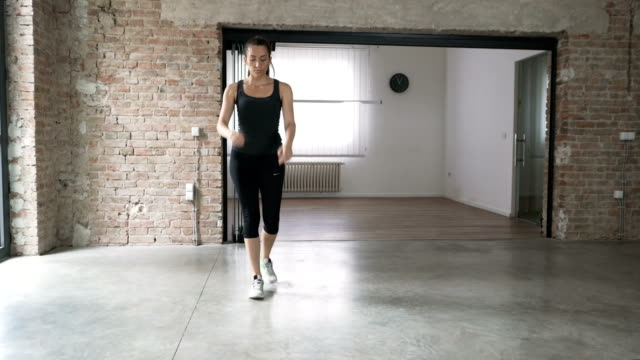 Young Woman Doing Lunge Variations At Home