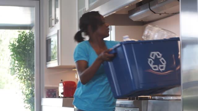 MS Young woman doing recycling around house, Phoenix, Arizona, USA