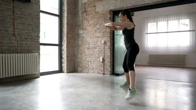 young woman doing side lunges with leg lift - lunge stock videos & royalty-free footage