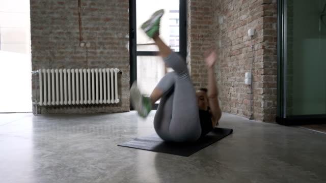 Young Woman Doing Single Leg Stand-Ups