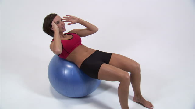 ws zi ms young woman doing sit ups on exercise ball / orem, utah, usa - fitness ball stock videos & royalty-free footage