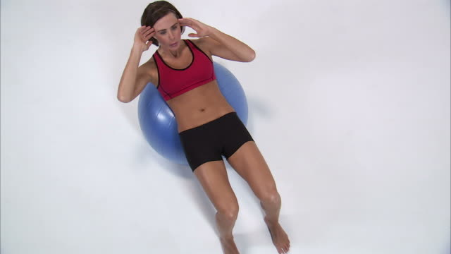 ws ha young woman doing sit ups on exercise ball / orem, utah, usa - fitness ball stock videos & royalty-free footage
