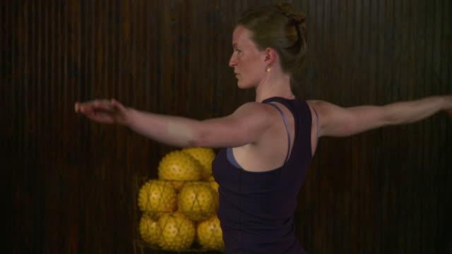 ms td tu young woman doing yoga / brooklyn, new york, usa - tiptoe stock videos & royalty-free footage