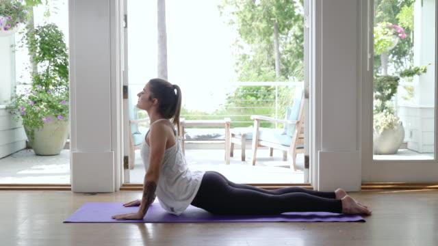 Young woman doing yoga, cobra position.