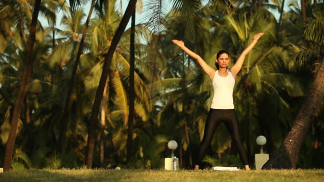 young woman doing yoga in morning  - sun salutation stock videos & royalty-free footage