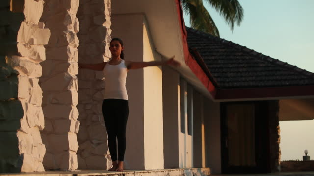 young woman doing yoga in morning  - sun salutation stock videos and b-roll footage