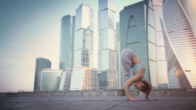 young woman doing yoga meditation exercises at sunset - posture stock videos and b-roll footage