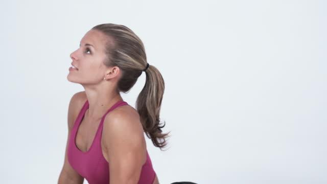 ms tu td pan young woman doing yoga / orem, utah, usa - orem video stock e b–roll