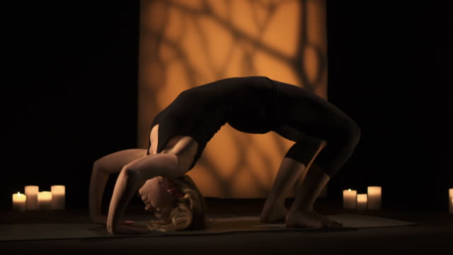 hd dolly: young woman doing yoga - exercise room stock videos & royalty-free footage