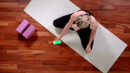 Young woman doing Yoga with smart phone