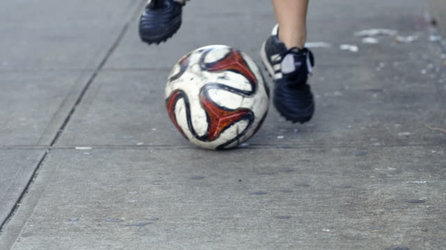 a young woman dribbles a soccer ball in the streets of new york - closeup - slow motion - 4k - lebanese ethnicity stock videos and b-roll footage