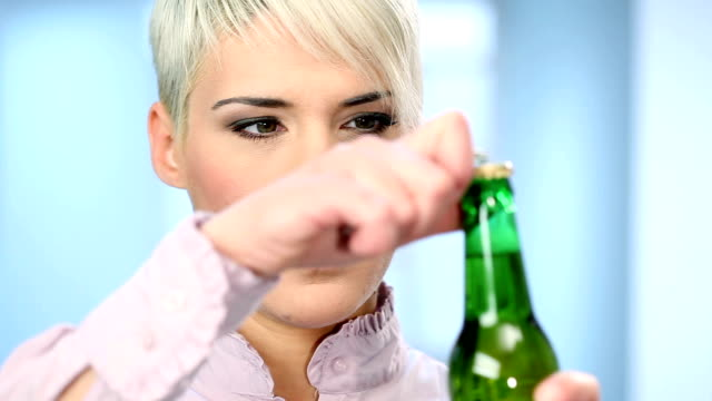 young woman drinking beer - beer bottle stock videos & royalty-free footage