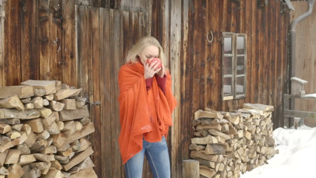 vidéos et rushes de young woman drinking coffee and smiling - chalet
