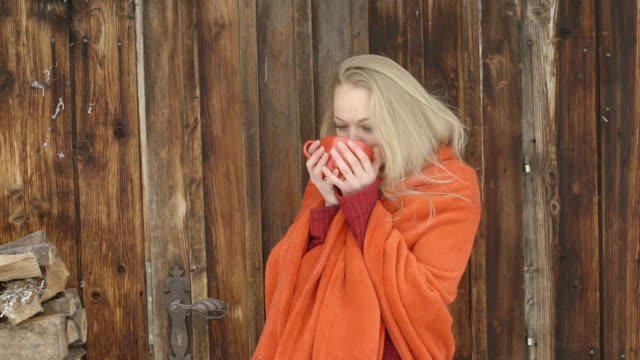 Young woman drinking coffee and smiling