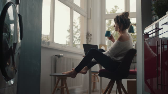 young woman drinking coffee at home in berlin - leggings stock videos & royalty-free footage