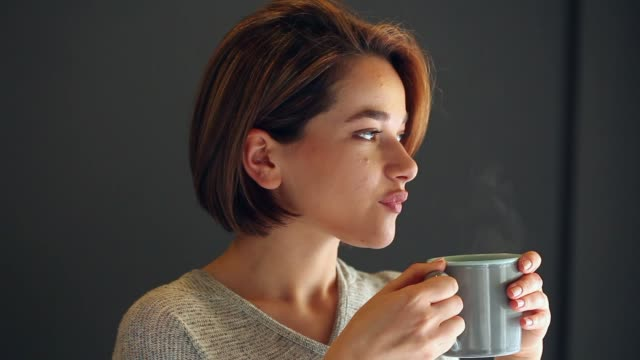 young woman drinking coffee - tea hot drink stock videos & royalty-free footage