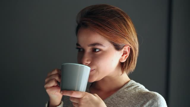 young woman drinking coffee - beautiful woman stock videos & royalty-free footage