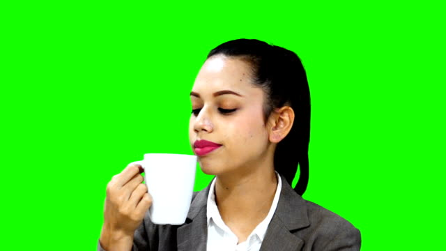 Young woman drinking coffee with smile on her face