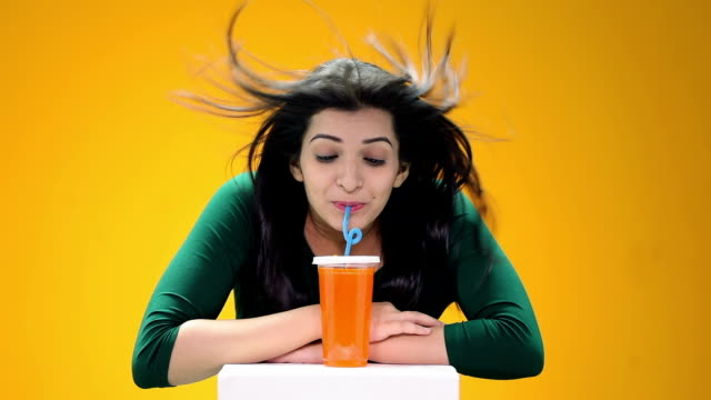 Young woman drinking cold drink