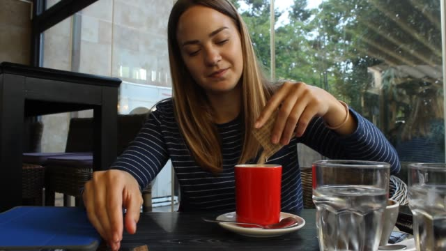 young woman drinking cream coffee - teaspoon stock videos and b-roll footage