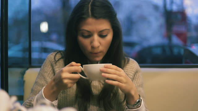 young woman drinking hot tea in the teahouse. - tea cup stock videos & royalty-free footage