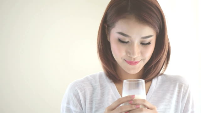 young woman drinking milk - vitamin a nutrient stock videos and b-roll footage