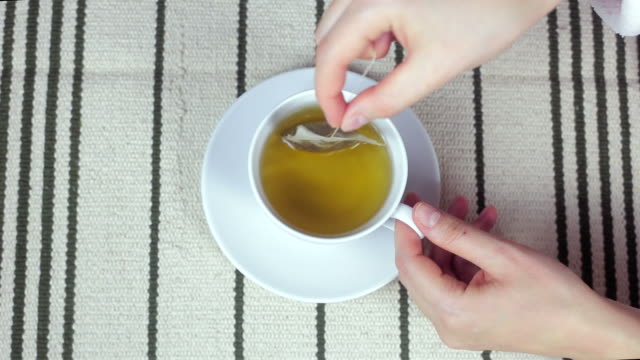 young woman drinking tea close up. - dried tea leaves stock videos & royalty-free footage