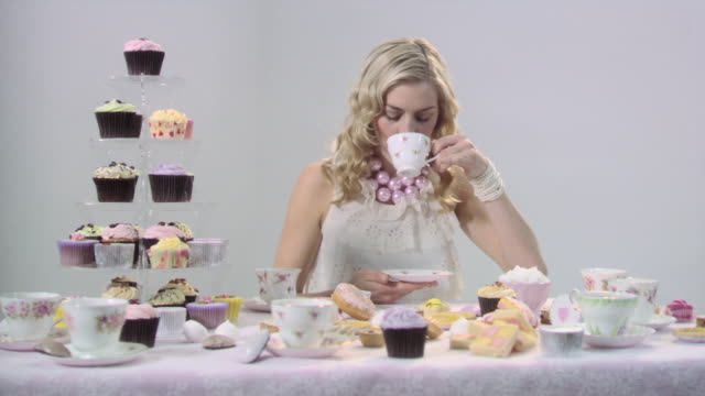 young woman drinking tea - tea party stock videos and b-roll footage