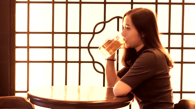 young woman drinking - beer glass stock videos & royalty-free footage