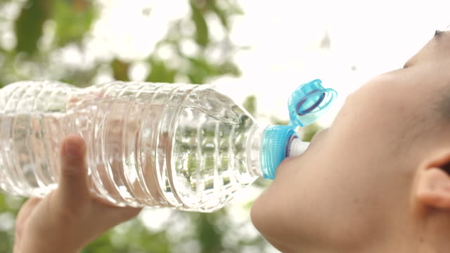 young woman drinking water after exercising - drinking water stock videos & royalty-free footage