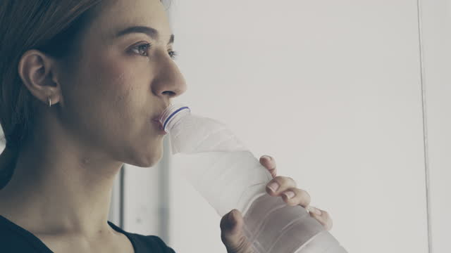 young woman drinking water after high intensity training - 2015 stock videos & royalty-free footage