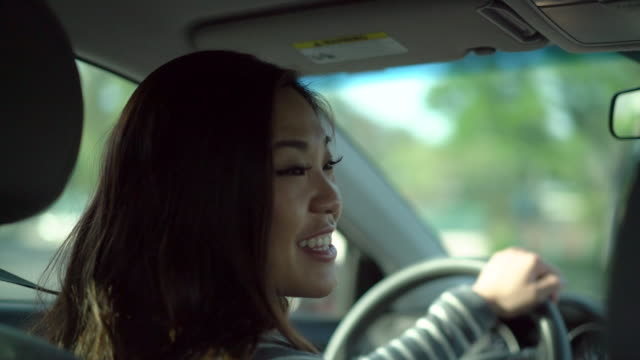 cu ts sm young woman driving a car smiling - sitting stock videos & royalty-free footage