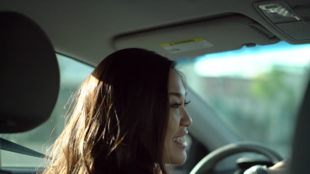 cu ts young woman driving her car - chinese ethnicity stock videos & royalty-free footage