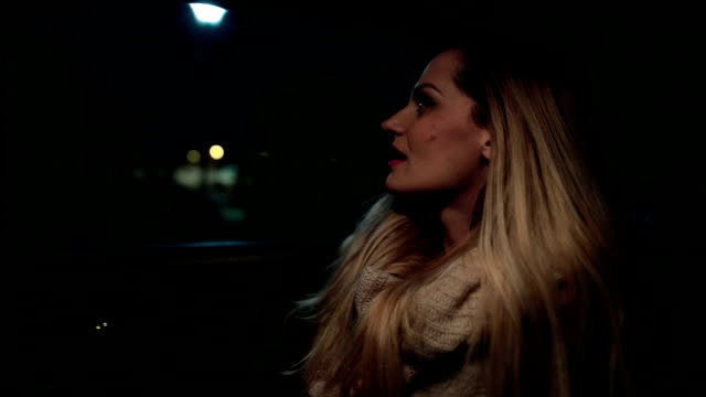 young woman driving in taxi at night - behind stock videos & royalty-free footage