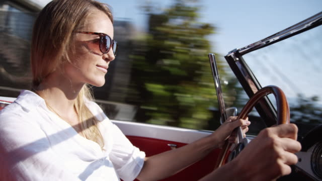 young woman driving - convertible stock videos & royalty-free footage