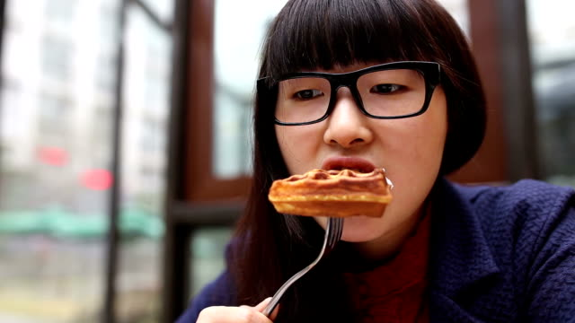 young woman eating cake - dessert stock videos & royalty-free footage