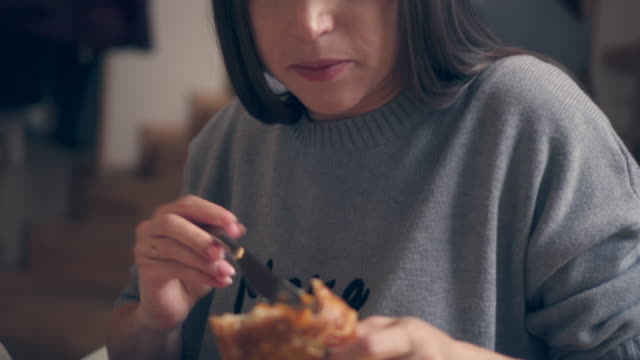 young woman eating croissant for breakfast - croissant stock videos & royalty-free footage