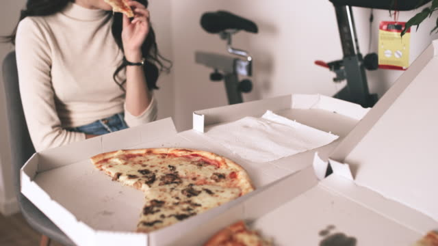ms young woman eating pizza - over eating stock videos & royalty-free footage