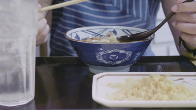 young woman eating ramen noodles - ramen noodles stock videos & royalty-free footage
