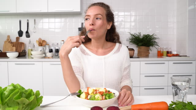 young woman eating salad - kitchenware department stock videos and b-roll footage