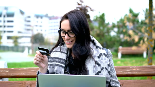 young woman e-banking with her laptop. - remote location stock videos & royalty-free footage