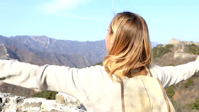 young woman embracing nature-great wall of china - great wall of china stock videos & royalty-free footage