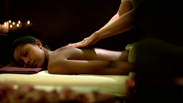 young woman enjoying a massage - massage table stock videos & royalty-free footage