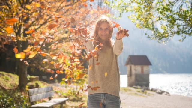 young woman enjoying autumn outdoors - beautiful woman stock videos & royalty-free footage