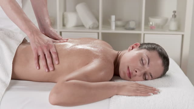 hd dolly: young woman enjoying back massage - massage table stock videos & royalty-free footage