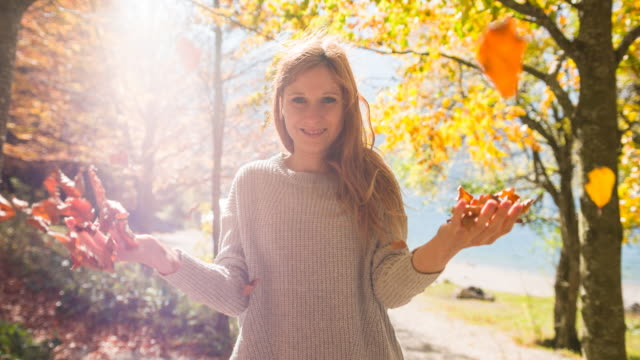 young woman enjoying beautiful sunny autumn day in nature - beautiful woman stock videos & royalty-free footage